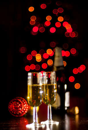 Spumante glasses on bokeh background. Christmas celebration concept