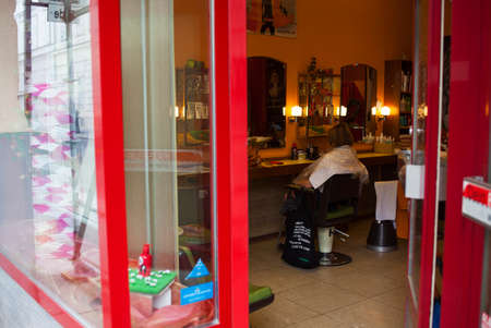 VIENNA, AUSTRIA - MAY, 22: Woman sitting in a barbers chairs waiting hairdresser in a hairdressing salon on May 22, 2018