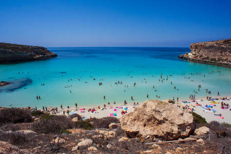 LAMPEDUSA, ITALY - AUGUST, 03: View of the most famous sea place of Lampedusa, It is named Spiaggia dei conigli,  in English language Rabbits Beach or Conigli island on August 03, 2018 Redakční