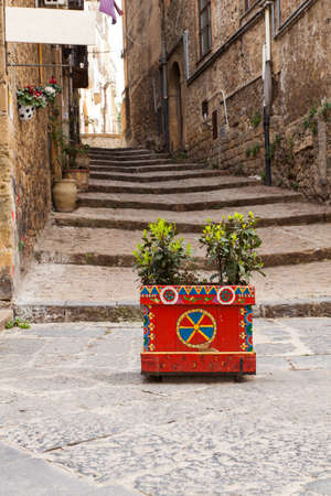 Decorated pot in the alley of Piazza Armerina, Sicily. Italy