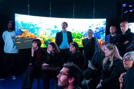 VENICE, ITALY - MAY 09:  Spectators looking the work by Hito Steyerl titled Leonardo's submarine exposed at the Central Pavilion during the 58th International Art exhibition of Venice biennale on May 09 2019