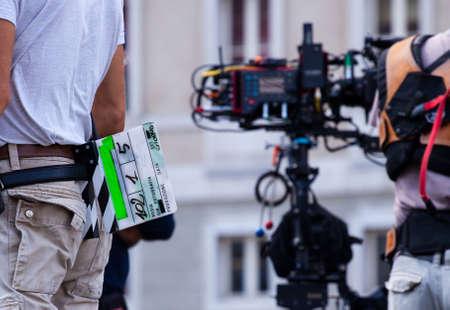 Behind the scene. Film crew team filming movie scene on outdoor location