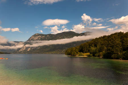 View of scenic Bohinj lake, the largest permanent lake in Slovenia, located within the Bohinj Valley of the Julian Alps