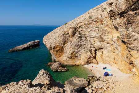 Stara Baska, Croatia - July, 22: Family relaxing in the Stara Baska beach during the summer season on July 22, 2020