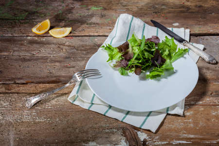 Plate with only salad without seasoning on wooden table Stok Fotoğraf