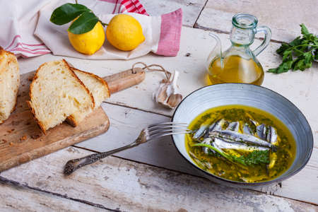 Marinated anchovies in lemon juice with olive oil garlic and parsley. Traditional mediterranean summer food