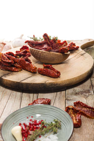 Close up of Mediterranean dried tomatoes on cutting board