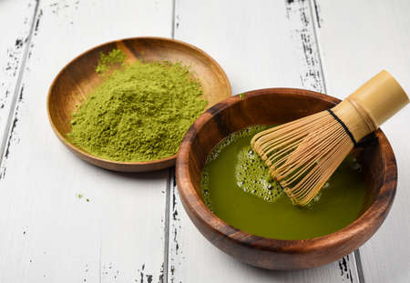 Japanese green tea matcha in a wooden bowl.