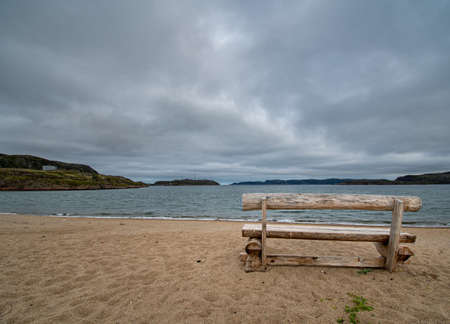 Lonely bench by the sea in autumn.