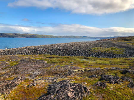 Murmansk region. The village of Teriberka. Shore of the Barents Sea. Beach with round stones