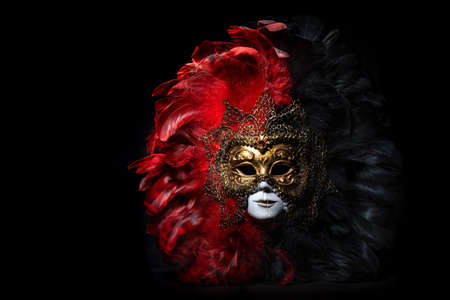 Italian carnival venetian mask on black background. Mysterious event, party
