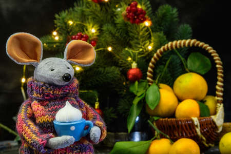 The symbol of the New Year 2020 is the mouse. With a cup of chocolate, tangerines, spruce branches.