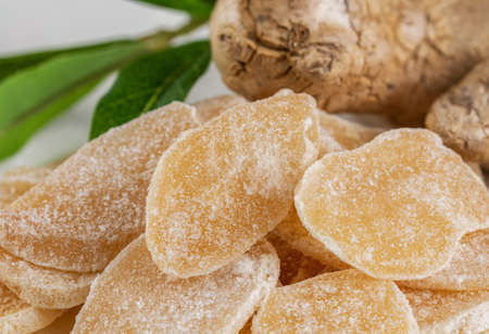 Sweet and Spicy Candied Ginger in a Bowl on light background. Copy space