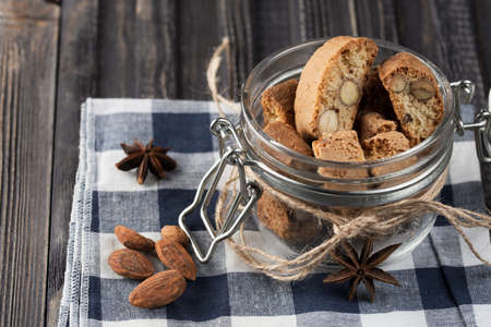Traditional italian Christmas New Year dry cookies biscuits biscotti cantuccini. Biscotti di Prato. In glass jar. 스톡 콘텐츠