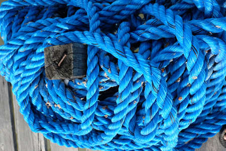 roll of old blue rope Archivio Fotografico