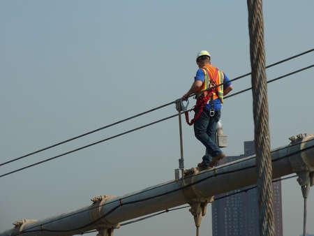 Construction worker on Brooklyn Bridge, New York
