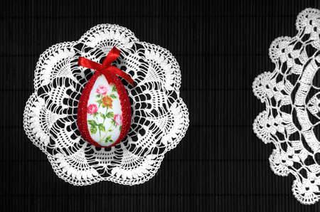 easteregg: Easter egg on lace and vertical black, bows in background