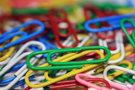secretary tray: Lots of colorful abstract paper clips close up Stock Photo