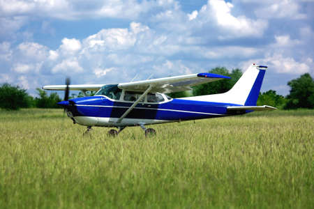 Light purple school airplane on airport grass before take off Editorial