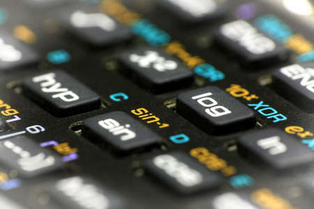tangent: Scientific calculator buttons close up with bright vignette