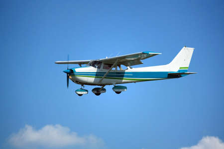 squawk: Light general aviation aircraft on final with cloud sky landing configuration