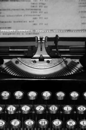 rewrite: Old typewriter with old paper close up