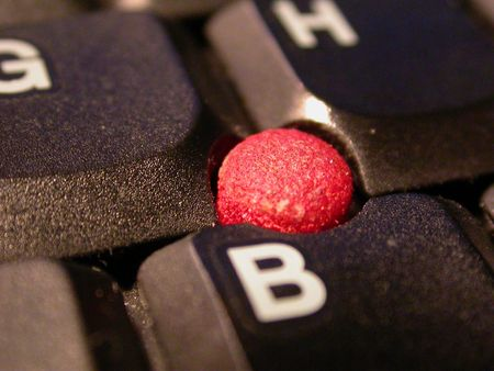 helvetica: A macro shot of a keyboard and trackpoint.