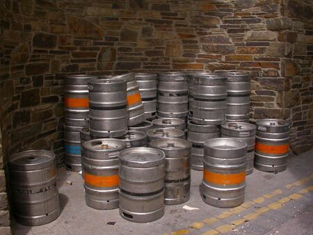 A stack of beer kegs in the alley of an Irish street in Killarney.