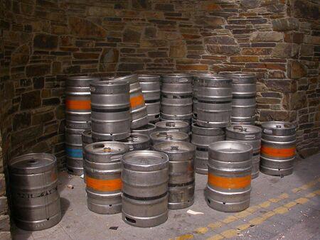 kegs: A stack of beer kegs in the alley of an Irish street in Killarney.