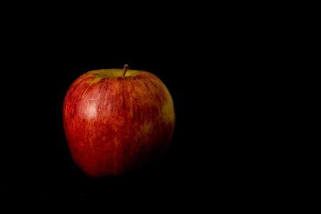 pomme: An apple spotlighted. Stock Photo