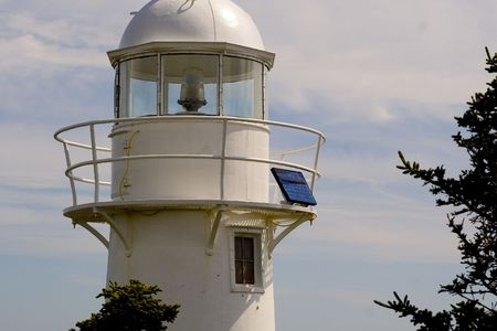 A lighthouse powered by solar panels on the east coast of Newfoundland, near Bay Bulls. 写真素材