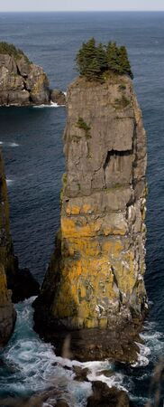 A huge sea stack on the east coast of the avalon peninsula, Newfoundland. Shot along the East Coast Trail- only accessible by foot or by boat.