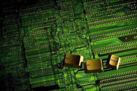 Ctrl Alt Delete keys placed on a backlight circuit board. photo