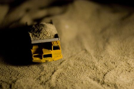 dump truck: Close photo of a toy dump truck.