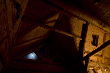 Log frame cabin under an unusually bright full moon.