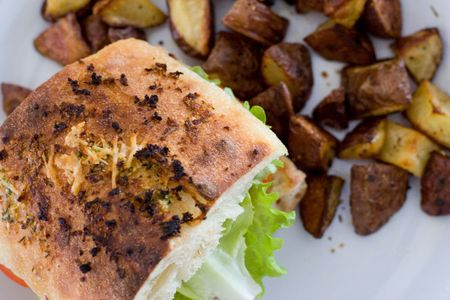 Grilled rosemary chicken sandwich, with potatoes. Stock fotó