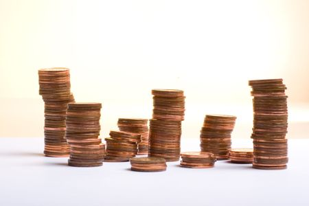 penny: Shot of towering stacks of pennies. ...a penny saved is a penny earned...