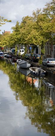 the netherlands: Canal scene in Haarlam, Netherlands.  Stock Photo