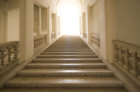 Looking up a stairway in an empty museum in Rome.