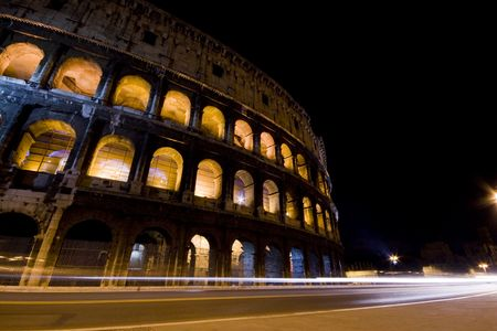 Photograph of the Roman Coliseum at night in Rome.