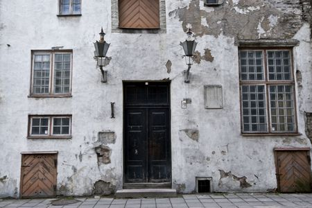 run down: Run down, delapitated doorway and facade of a residential building in downtown Tallinn, Estonia.  Stock Photo