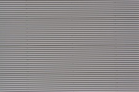 gritty: Corrugated steel texture in an industrial district of Barcelona. Stock Photo