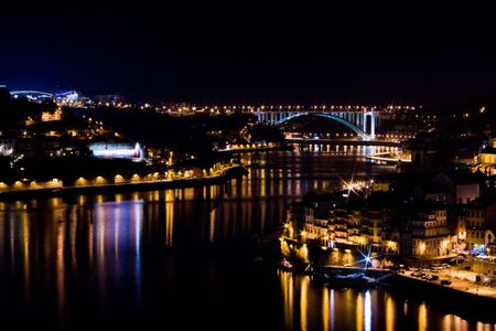 Looking down at Oporto and Gaia at night.  写真素材