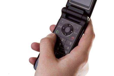 sleek: Dialing a phone number on a sleek, slim, new phone.
