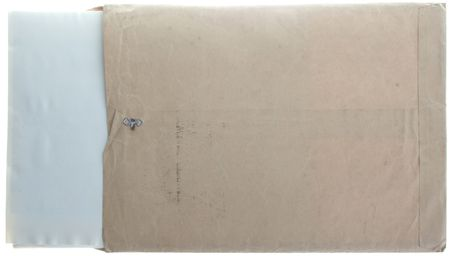 old envelope: Vintage worn manilla envelope with paper sticking out.  Stock Photo