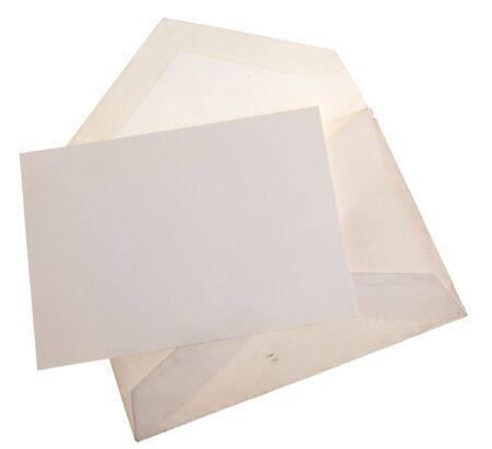 old envelope: Vintage old envelope with blank sheet of paper.  Stock Photo