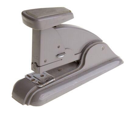 office stapler: Old vintage grey stapler, glassy office supply.  Stock Photo
