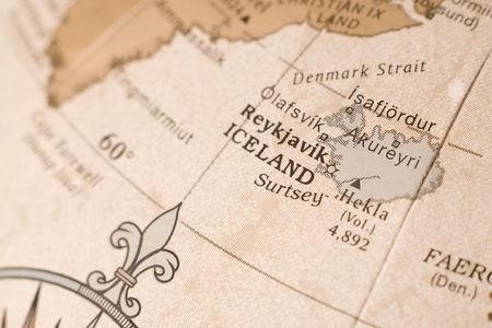 Close up on a globe showing Iceland in detail.