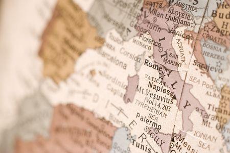 venice: Close up shot of Rome, Italy on an English globe.