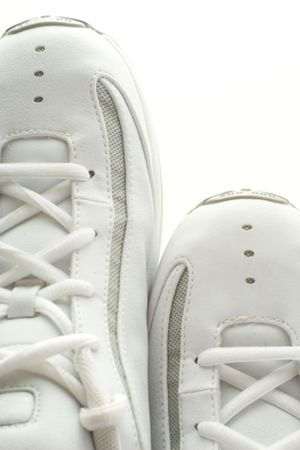 Pair of basketball shoes side by side.